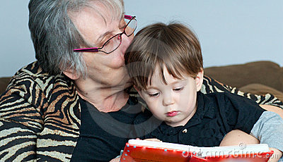 Grandmother reading to grandchild