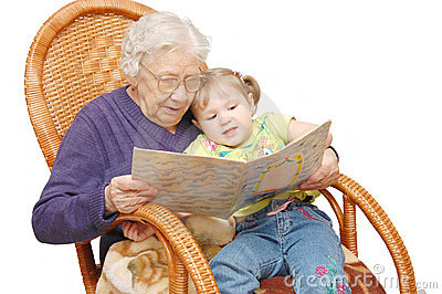 Grandmother reads to the granddaughter
