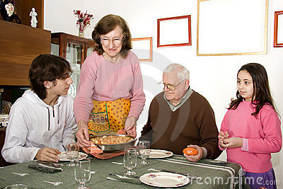 Grandmother serving food