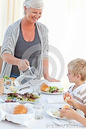 Grandmother serving her grandchildren