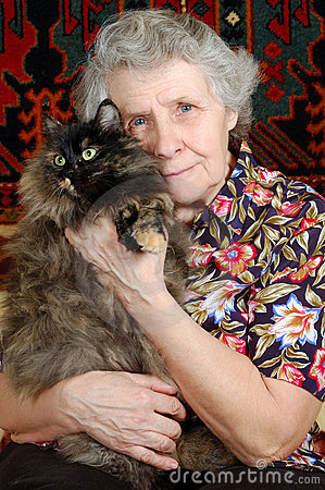 Free Grandmother Sitting With Cat On Her Hands Royalty Free Stock Photos - 4776238