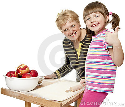 Grandmother teaching her granddaughter cooking