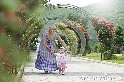 Grandmother teaching little girl to walk