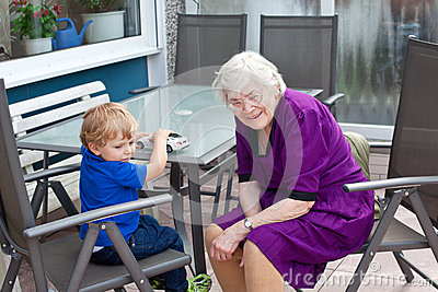 Grandmother and toddler boy  in summer