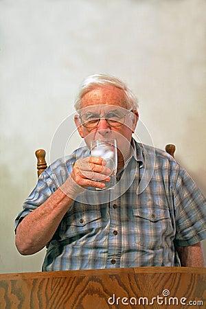 Grandpa drinks ice water