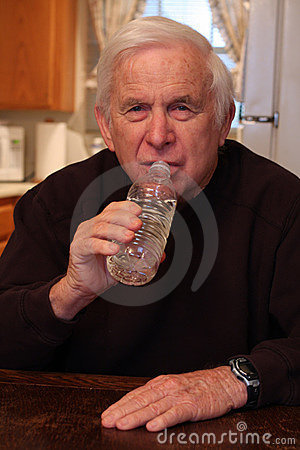 Grandpa drinks from water bottle
