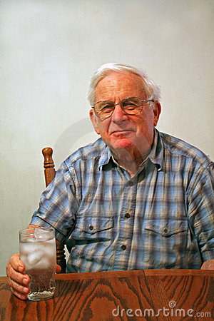 Grandpa with glass of iced water