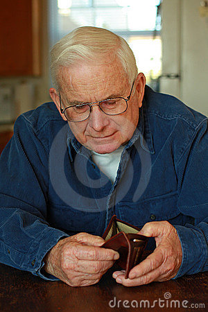 Grandpa looking in empty wallet