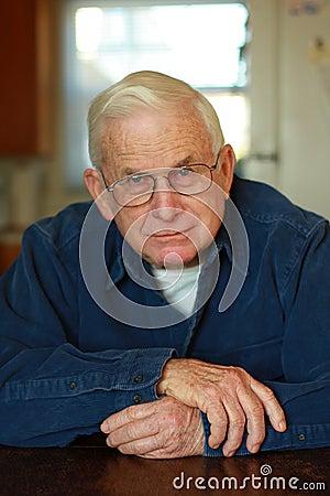 Grandpa relaxing at table