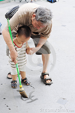 Grandpa teaches grandson to write Editorial Photo