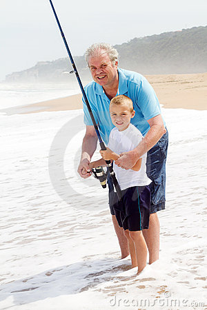Grandpa teaching grandson fishing