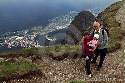 Grandparents and child hiking