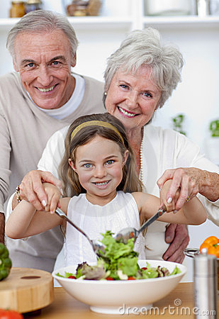 Grandparents eating a salad with granddaughter