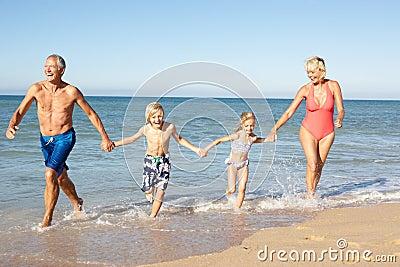 Grandparents With Grandchildren On Beach.
