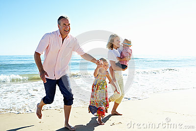 Grandparents And Grandchildren On Beach