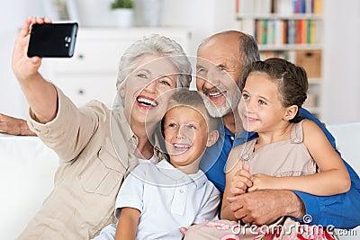 Grandparents and grandchildren with a camera