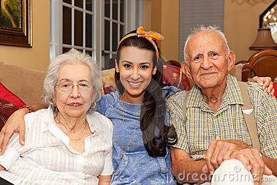 Grandparents and Granddaughter Stock Photo