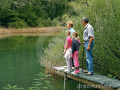 Grandparents and granddaughters on river