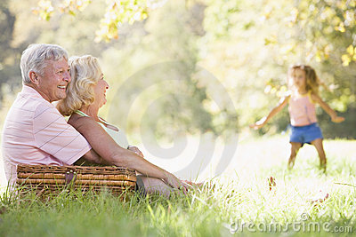 Grandparents at a picnic with young girl