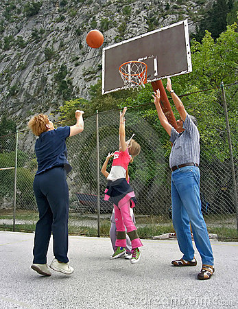 Grandparents play basketball