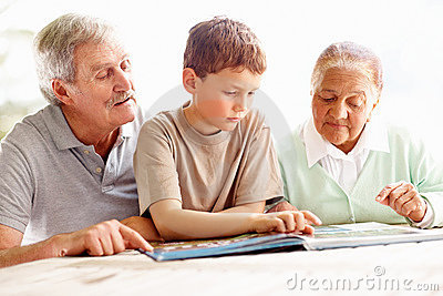 Grandparents Reading A Story Book With Grandson Stock Photography - Image: 11315612