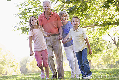 Grandparents walking with grandchildren