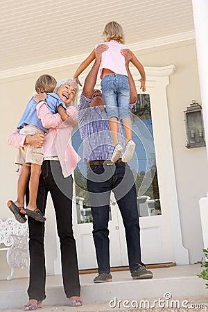 Grandparents Welcoming Grandchildren On Visit