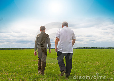 Grandson and  grandfather in  field