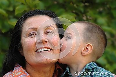 Grandson kissing his granny