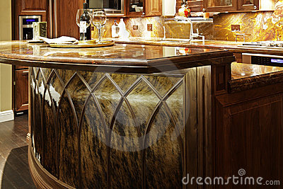 Granite counter tops and wood kitchen furniture.