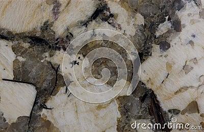 Granite. Pale yellow and reddish-brown shades.