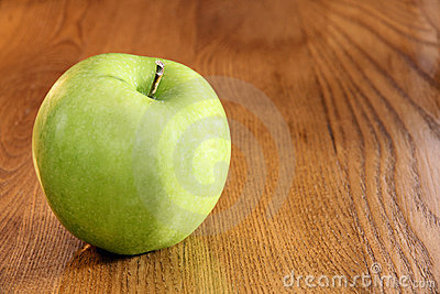 Granny smith apple on table