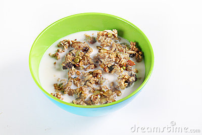 Granola cereal with milk on white