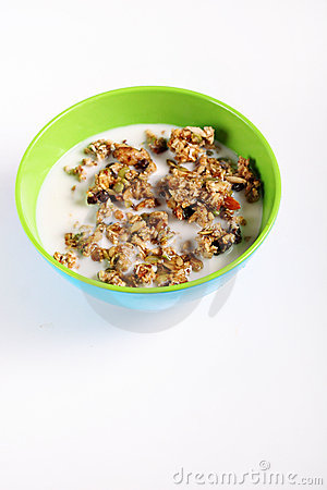 Granola cereal with milk on white vertical