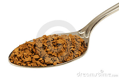 Granules of instant coffee in the spoon