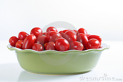 Grape tomatoes in a bowl on white