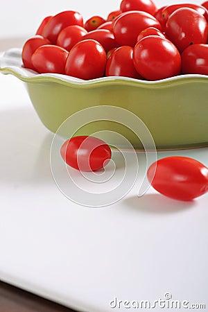 Grape tomatoes on white