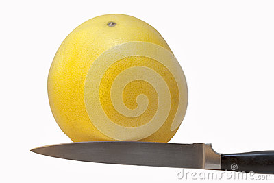 Grapefruit and kitchen knife
