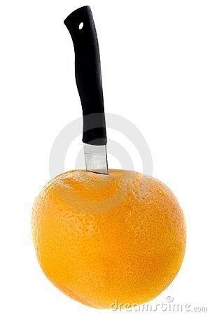 Grapefruit with knife