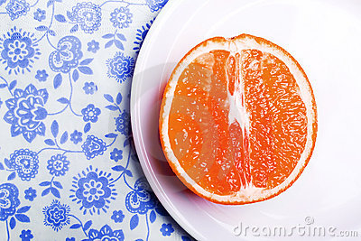 Grapefruit on plate on napkin