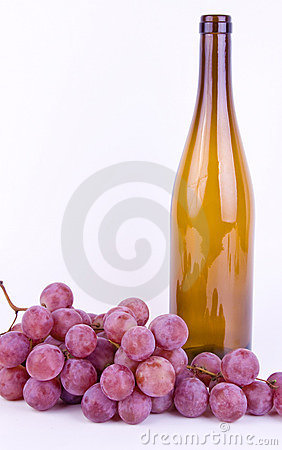 Grapes with bottle on white