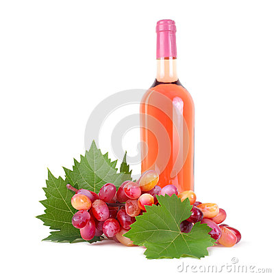 Grapes with leaf and wine bottle isolated on white