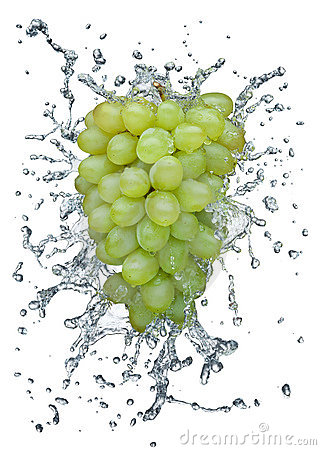 Grapes splashing in water