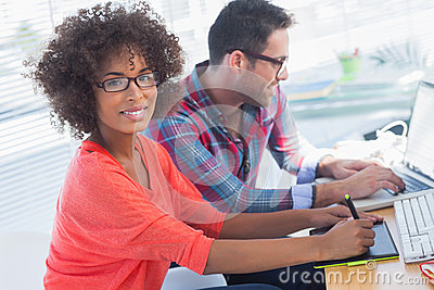 Graphic designer using a graphics tablet in her office