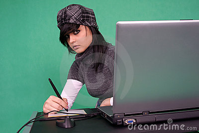 Graphic designer working with tablet pen.