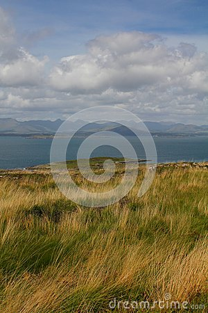 Grass covered cliffs overlooking peninsula and sea