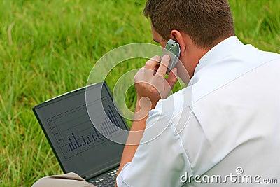 Grass laptop man sitting