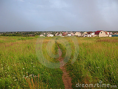 Grassland landscape with foot-path before storm