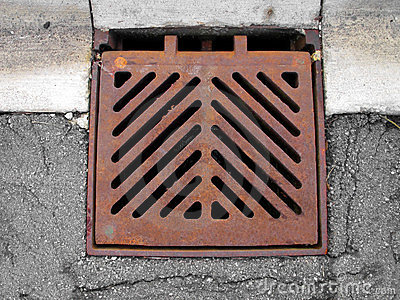 Grate Covering A Storm Sewer Drain Royalty Free Stock