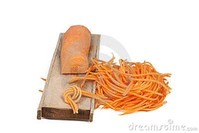 Grated Carrot Sticks And A Wooden Grater Stock Photography - Image: 18049562